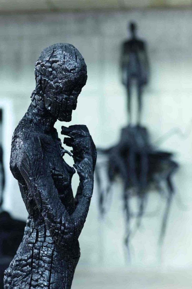 Charcoal sculptures by Aron Demetz
